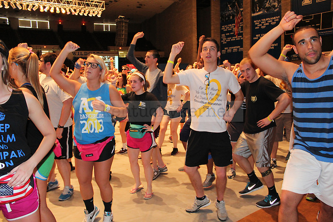 Students dancing at DanceBlue, a 24 hour dance marathon to raise money for pediatric cancer research at Memorial Coliseum in Lexington, Ky. on Saturday, February 23, 2013.  Photo by Logan Douglas   Staff.