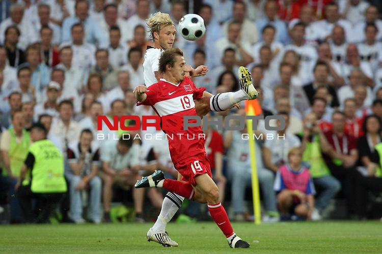 UEFA Euro 2008 Semi-Finals Match 29 Basel - St. Jakob-Park. Deutschland ( GER ) - T&uuml;rkei ( TUR ). <br /> Simon Rolfes ( Germany / Mittelfeldspieler / Midfielder / Bayer 04 Leverkusen #06 ) (l) im Kampf um den Ball mit Ayhan Akman ( T&uuml;rkei / Mittelfeldspieler / Midfielder / Galatasaray Istanbul #19 ) (r).<br /> Foto &copy; nph (  nordphoto  )
