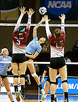 SIOUX FALLS, SD - DECEMBER 8:  Sarah Ragland #5 from Palm Beach Atlantic reaches back to tip the ball past Taylor Stratton #3 and Kassy Johannsen #21 from the University of South Carolina Aiken during their quarterfinal match of the NCAA DII Volleyball Championships at the Sanford Pentagon in Sioux Falls, SD. (Photo by Dave Eggen/Inertia)