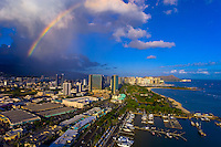 Aerial view of the Kewalo Boat Basin with Waikiki and Diamond Head in background and a rainbow overhead, Honolulu, Oahu, Hawaii, USA