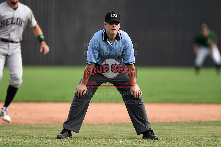 Umpire Richard Riley during a game between the Beloit Snappers and Clinton LumberKings on August 17, 2014 at Ashford University Field in Clinton, Iowa.  Clinton defeated Beloit 4-3.  (Mike Janes/Four Seam Images)