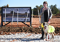 NWA Democrat-Gazette/DAVID GOTTSCHALK Courtney Kremer, director of Animal Services for the City of Springdale, participates Tuesday, October 8, 2019, with her dog Rufus in the ground breaking ceremony for the new Animal Shelter and Adoption Center of Springdale. The new facility, located at 1549 E. Don Tyson Parkway, was made possible by a 2018 $200 million bond program voted on by residents that also includes money for streets, fire stations and a new city administration building.