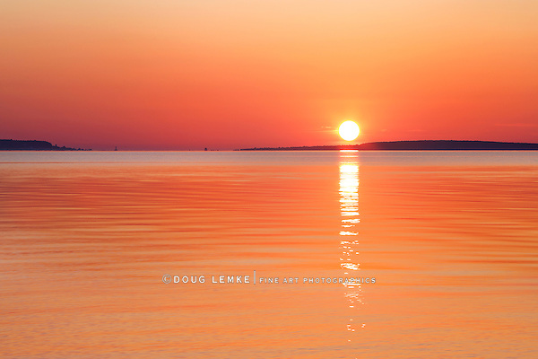 A Great Lakes Sunrise Over The Straits Of Mackinac At Old Mackinac Point, Michigan, USA