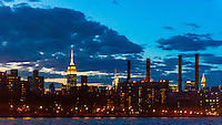View from the East River of the Empire State Building  on left and Chrysler Building on right with East River Generating Station  (power plant) in middle, New York, New York USA.