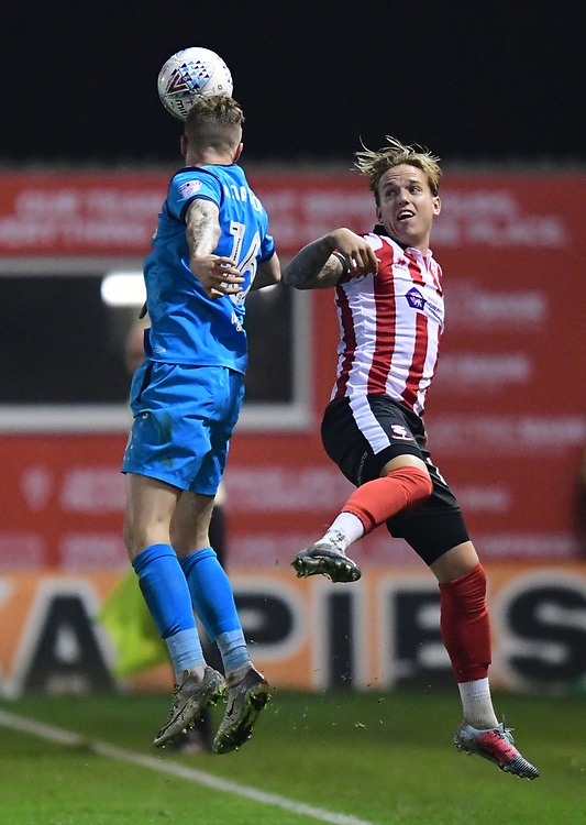 Lincoln City's Jordan Maguire-Drew vies for possession with Barnet's Harry Taylor<br /> <br /> Photographer Andrew Vaughan/CameraSport<br /> <br /> The EFL Sky Bet League Two - Tuesday 26th September 2017 - Lincoln City v Barnet - Sincil Bank - Lincoln<br /> <br /> World Copyright &copy; 2017 CameraSport. All rights reserved. 43 Linden Ave. Countesthorpe. Leicester. England. LE8 5PG - Tel: +44 (0) 116 277 4147 - admin@camerasport.com - www.camerasport.com