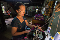 Myanmar/Burma, Bago District, Daik-U Township.<br /> Thin Thin Khaing runs a home based sewing business. She received a BRAC loan for $300 and bought some cloth. She already had these sewing machines, although she would like to be able to upgrade to a new electric machine. Individual people come in for orders and she makes about $20 a day. Her husband works in government work and he makes about $300-$500 a month. They have two daughters and the oldest studies zoology at university. She wants her daughters to be well educated and maybe be a teacher, but to also learn sewing to fall back on. Model released, MR-Myanmar-130