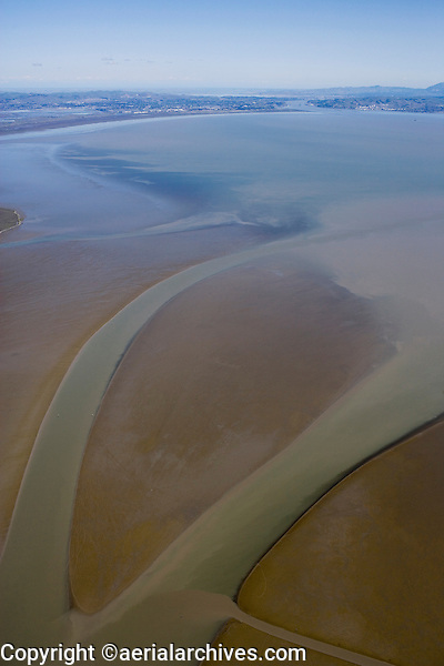Sediment deposit visible at low tide at the mouth of the Petaluma river, northern San Francisco bay also known as San Pablo bay.