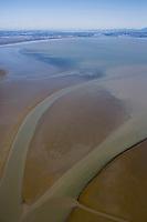 Sediment deposit visible at low tide at the mouth of the Petaluma river, northern San Francisco bay also known as San Pablo bay.