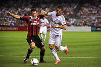 Daniele Bonera (25) of A. C. Milan and Cristiano Ronaldo (7) of Real Madrid. Real Madrid defeated A. C. Milan 5-1 during a 2012 Herbalife World Football Challenge match at Yankee Stadium in New York, NY, on August 8, 2012.