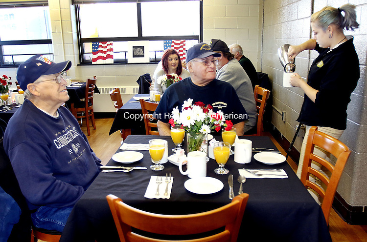 WATERBURY CT. 08 November 2016-110816SV04-From left, Bob Jones of Torrington and Joe Rinaldi of Falls Village are served coffee by Tegan Williams, 17, of Litchfield during a breakfast prepared for them by culinary students at Oliver Wolcott Technical High School in Torrington Thursday. The breakfast was in honor of Veterans Day.<br /> Steven Valenti Republican-American