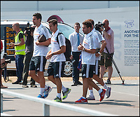 BNPS.co.uk (01202 558833)<br /> Pic: PhilYeomans/BNPS<br /> <br /> Players emerge from the terminal building.<br /> <br /> Footballing aristocrats Real Madrid flew into the unlikely enviroment of Bournemouth today for a much anticipated friendly against the seaside town's football team.<br /> <br /> Despite fears that their second team would turn up excited fans at the airport couldn't beleive their eyes when Ancelotti led out Ronaldo, Zidane, Kaka, Modric and many more stars from the terminal building.