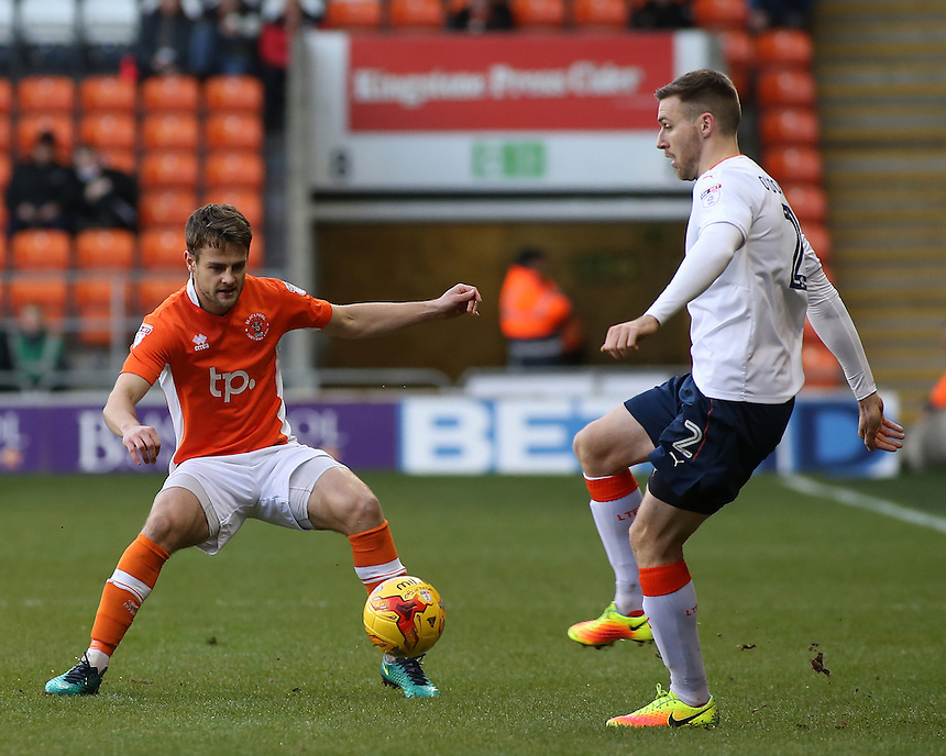Luton Town's Stephen O'Donnell plays the ball past Blackpool's Andy Taylor<br /> <br /> Photographer David Shipman/CameraSport<br /> <br /> The EFL Sky Bet League Two - Blackpool v Luton Town - Saturday 17th December 2016 - Bloomfield Road - Blackpool<br /> <br /> World Copyright &copy; 2016 CameraSport. All rights reserved. 43 Linden Ave. Countesthorpe. Leicester. England. LE8 5PG - Tel: +44 (0) 116 277 4147 - admin@camerasport.com - www.camerasport.com