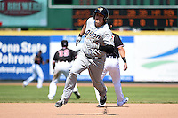 Akron RubberDucks first baseman Bryan LaHair (16) runs the bases after hitting a triple during a game against the Erie SeaWolves on May 18, 2014 at Jerry Uht Park in Erie, Pennsylvania.  Akron defeated Erie 2-1.  (Mike Janes/Four Seam Images)