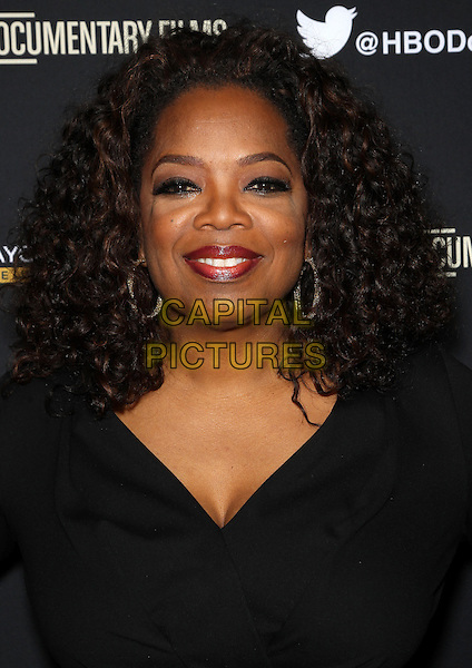Hollywood, CA - March 10: Oprah Winfrey Attending Premiere Of HBO Documentary Films' &quot;Paycheck To Paycheck&quot;, Held at Linwood Dunn Theater California on March 10, 2014.<br /> CAP/MPI/RTNUPA<br /> &copy;RTNUPA/MediaPunch/Capital Pictures