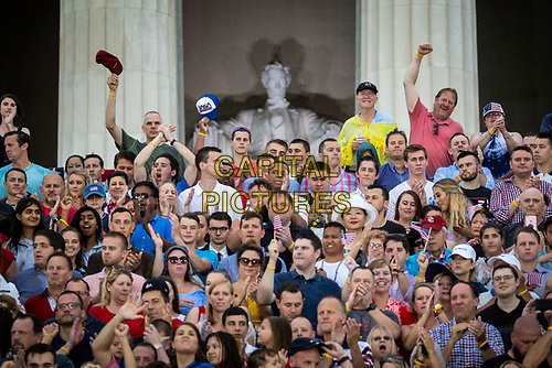 """Attendees cheer before U.S. President Donald Trump speaks during the Fourth of July Celebration 'Salute to America' event in Washington, D.C., U.S., on Thursday, July 4, 2019. The White House said Trump's message won't be political -- Trump is calling the speech a """"Salute to America"""" -- but it comes as the 2020 campaign is heating up. <br /> h<br /> CAP/MPI/CNP<br /> ©CNP/MPI/Capital Pictures"""