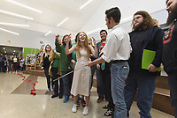 NWA Democrat-Gazette/FLIP PUTTHOFF <br /> ACADEMY CELEBRATION<br /> Arkansas Arts Academy seniors, including Claire Post (center), cheer Thursday March 14 2019 after a ribbon cutting to celebrate completion of the Arkansas Arts Academy high school campus at Fifth and Poplar streets in Rogers. Students gave tours of the building, including a culinary arts kitchen and pottery lab, after the ribbon cutting. The campus went through a $22 million renovation that increased the square footage from 56,000 to 99,000 square feet. The growth allows increased enrollment and course offerings.
