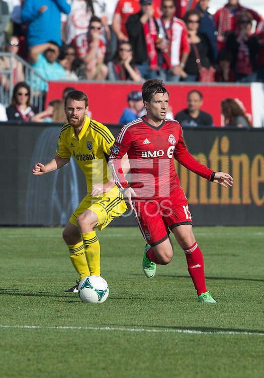 18 May 2013: Toronto FC midfielder Bobby Convey #15 and Columbus Crew midfielder/forward Eddie Gaven #12 in action during an MLS game between the Columbus Crew and Toronto FC at BMO Field in Toronto, Ontario Canada..The Columbus Crew won 1-0...