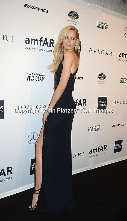 Karolina Karkova attends the amfAR New York Gala on February 5, 2014 at Cipriani Wall Street in New York City.