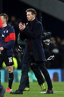 RB Leipzig manager Julian Nagelsmann applauds the visiting fans after Tottenham Hotspur vs RB Leipzig, UEFA Champions League Football at Tottenham Hotspur Stadium on 19th February 2020