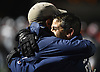 Cold Spring Harbor athletic director Mike Bongino, right, hugs varsity football hesd coach Jon Mendreski as the clock ticks down on the team's 27-7 win over Seaford in the Nassau County Conference IV final at Shuart Stadium in Hempstead on Friday, Nov. 16, 2018.