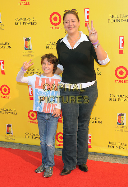 CAMRYN MANHEIM & son MILO.at The 2008 P.S. Arts' Express Yourself sponsored by Target held at Barker Hangar in Santa Monica, California, USA,  November 16th 2008.                                                                     .full length black  Jumper sweater jeans family son child kid mother white shirt v peace sign .CAP/DVS.©Debbie VanStory/Capital Pictures