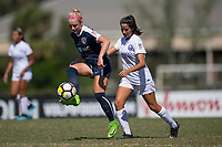 Sanford, FL - Saturday Oct. 14, 2017:  A Courage players passes the ball away from pressure during a US Soccer Girls' Development Academy match between Orlando Pride and NC Courage at Seminole Soccer Complex. The Courage defeated the Pride 3-1.
