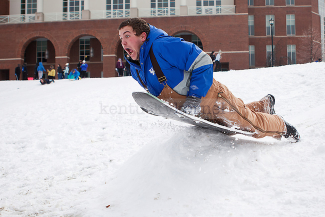 "Ben Connor sleds over a ramp in ""the Bowl"" outside the William T. Young Library in Lexington, Ky., on Monday, February 3, 2014. Photo by Emily Wuetcher  