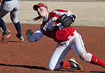 March 10, 2012:   Wisconsin Badgers second baseman Whitney Massey flips the ball to first against the Nevada Wolf Pack during their NCAA softball game played as part of the The Wolf Pack Classic at Christina M. Hixson Softball Park on Saturday in Reno, Nevada.