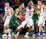 SIOUX FALLS, SD - MARCH 8:  Zach Rammelt #12 from North Dakota State looks to drive against Deondre Parks #0 from South Dakota State during the 2016 Summit League Championship Game Tuesday at the Denny Sanford Premier Center in Sioux Falls, S.D. (Photo by Dave Eggen/Inertia)