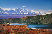 Canoers paddle Wonder Lake, autumn Alaska Range, Denali National Park, Alaska