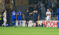 Referee Kevin Friend shows points Liam Cooper of Leeds United (far right) off the field after showing him a red card during the Sky Bet Championship match between Cardiff City and Leeds United at the Cardiff City Stadium, Cardiff, Wales on 26 September 2017. Photo by Mark  Hawkins / PRiME Media Images.