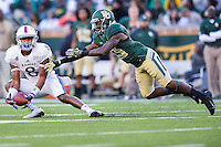 Kansas wide receiver Nick Harwell (8) catches a pass defended by Baylor safety Terrell Burt (13) during NCAA football game, Saturday, November 01, 2014 in Waco, Tex. Baylor defeated Kansas 60-14. (Mo Khursheed/TFV Media via AP Images)