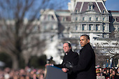 United States President Barack Obama, right, listens as President Francois Hollande of France speaks during an arrival ceremony on the South Lawn of the White House in this photograph taken with a tilt-shift lens in Washington, D.C., U.S., on Tuesday, Feb. 11, 2014.Credit: Andrew Harrer / Pool via CNP