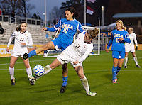 Kodi Lavrusky (10) of UCLA fights for the ball with Isabella Schmid (11) of Florida State during the NCAA Women's College Cup finals at WakeMed Soccer Park in Cary, NC.  UCLA defeated Florida State, 1-0, in overtime.