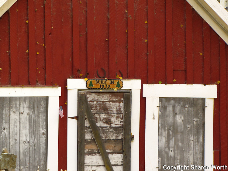 """A red cabin near Lundy Lake proudly displays it age:  """"Built In 1879."""""""
