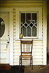 A chair on a porch
