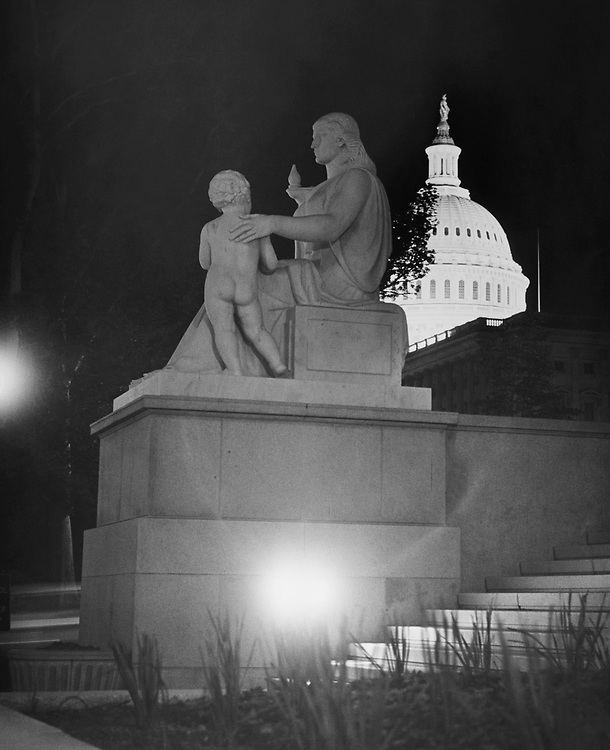Night shot of Capitol Hill and Statue at Rayburn Building. (Photo by Mickey Senko/CQ Roll Call via Getty Images)