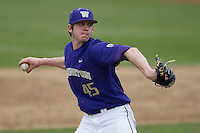Washington Huskies pitcher Trevor Dunlap (45) delivers a pitch to the plate during the NCAA baseball game against the Michigan Wolverines on February 16, 2014 at Bobcat Ballpark in San Marcos, Texas. The game went eight innings, before travel curfew ended the contest in a 7-7 tie. (Andrew Woolley/Four Seam Images)