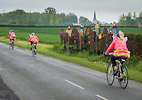 Cyclists in fancy dress passing Agincourt knights on the third day of the Help for Heroes Big Battlefields Bike Ride from Paris to London. This day commenced at Amiens and ended at Le Touquet in Picardie, France, a distance of approximately 90 miles. The ride went through Azincourt and hence across the battlefield of Agincourt, the site of the important English victory under King Henry V, against France under Charles VI, in 1415. Lunch was taken at the Agincourt visitors centre. The final stop prior to destination was in the fortress town of Mntreuil-sur-Mer, once a sea port on the estuary of Canche, being the town where Haig chose to set up his GHQ (General Headquarters) in 1916.  Thursday 30th May 2013.