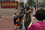 Shanghai - People's Republic of China, May 27, 2013 -- Visitors, local tourists, taking their picture at famous Nanjing Lu / Road East, pedestrian shopping mall, Huangpu District ; commerce, business, people, photography -- Photo: © HorstWagner.eu