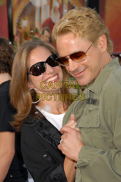"ROBERT DOWNEY JR. & wife SUSAN.""Fred Claus"" Los Angeles Premiere at Grauman's Chinese Theatre, Hollywood, California, USA, 3 November 2007..half length holding hands snowing dancing funny sunglasses.CAP/ADM/BP.©Byron Purvis/AdMedia/Capital Pictures."