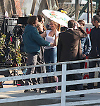 .1-27-2010  ...Tom Cruise Rubbing sunscreen on his hands and arms. Getting makeup put on his neck.Throwing a bean bag to another actor. Tom had a gun pulled on him while filming next to a plane that turned into a hostage situation. Tom was  eating yogurt & running to save a hostage while holding guns. Cameron Diaz was laughing & playing with a baby & holding an umbrella until her scene with Tom was ready to shoot. Tom would jump rump and do push ups in between filming. The last scene Cameron was holding Tom because he was hurt. They were filming in Long Beach California ....www.AbilityFilms.com.805-427-3519.AbilityFilms@yahoo.com
