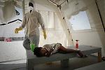 The cholera epidemic in Haiti has already killed 4.500 people and sickened more than 250.000. Un enfermero desinfecta con cloro alrededor de una niña enferma de Colera en un centro de asistencia en un barrio de Puerto Principe