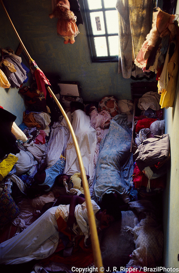Dwelling conditions at Rio de Janeiro favela, Brazil. The whole family sleeps together in a one-room house at favela da Maré.