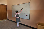 18/04/15. Goktapa, Iraq. Dhuha learning kurdish special characters at the whiteboard.