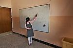 18/04/15. Goktapa, Iraq. Dhuha learning kurdish special characters at the whiteboard.