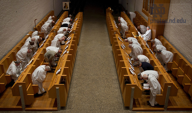 January 15, 2012; Trappist monks bow during Vespers. The University of Notre Dame Folk Choir held a concert for the Monastic and local community during their 2012 retreat at The Abbey of Gethsemani, Trappist, Kentucky. Photo by Barbara Johnston/University of Notre Dame