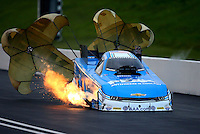 Jun 20, 2015; Bristol, TN, USA; Fire comes from the car of NHRA funny car driver John Force after backfiring the engine during qualifying for the Thunder Valley Nationals at Bristol Dragway. Mandatory Credit: Mark J. Rebilas-USA TODAY Sports