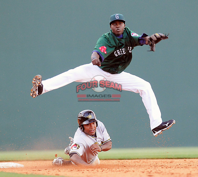 Greenville Drive shortstop Vladimir Frias 15)goes airborne to put out the West Virginia Power's Evan Chambers (53) at second and turn a game-ending double play on May 2, 2010, at Fluor Field at the West End in Greenville, S.C.