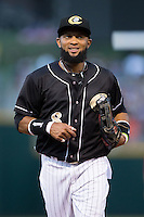 Charlotte Knights center fielder Emelio Bonifacio (8) jogs off the field between innings of the game against the Gwinnett Braves at BB&T BallPark on August 11, 2015 in Charlotte, North Carolina.  The Knights defeated the Braves 3-2.  (Brian Westerholt/Four Seam Images)
